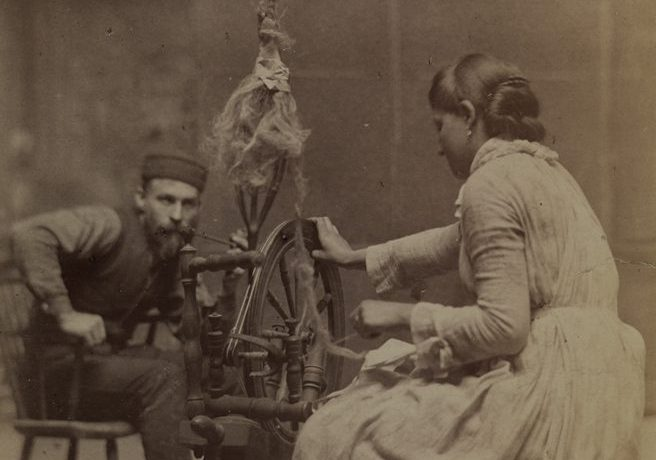 Female model spinning while man watches